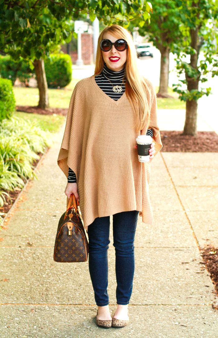 Love the poncho! The material looks so nice and thick – perfect for the winter! The colors of the patterns on your sweater also make it a great match for both your camel-colored poncho and black pants.